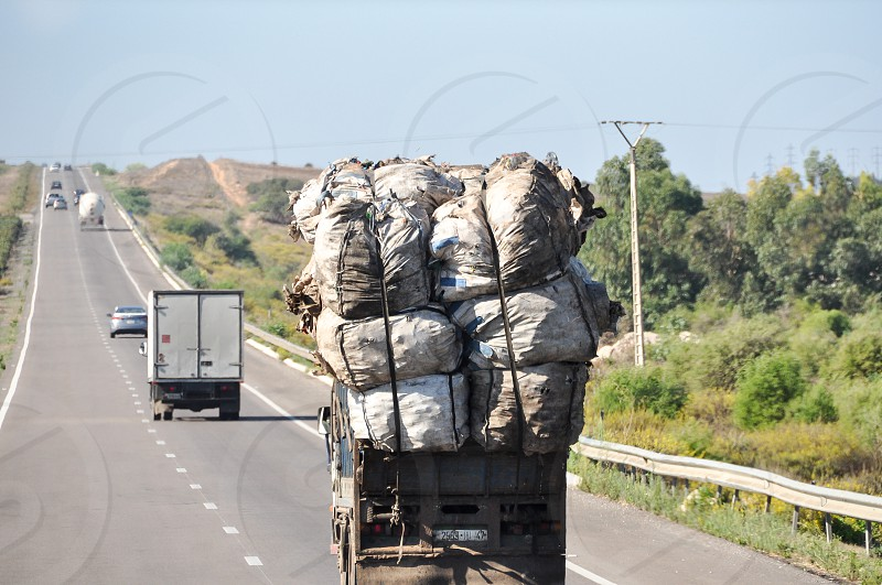 Overloaded truck on the roads of Morocco photo