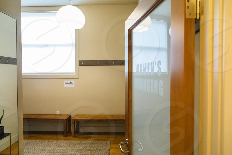 brown and white glass door on brown floor room photo