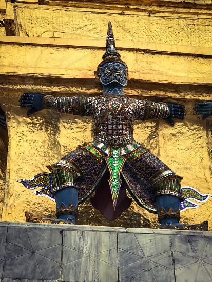 Outdoor day vertical portrait colour Grand Palace Bangkok Thailand Asia East eastern Far East temple Shrine monument statue mosaic tile gold golden gold leaf decorative king royal regal travel tourist tourism wanderlust photo