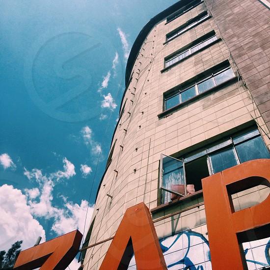 beige 6 storey building photo
