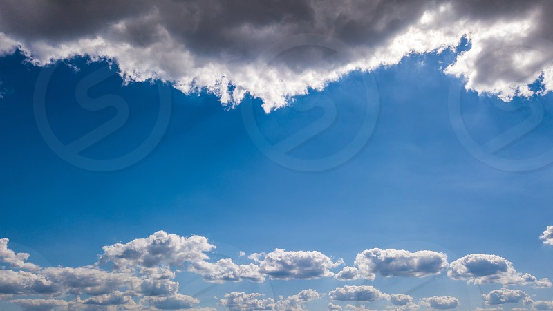 Blue sky with lots of clouds. Beautiful natural layout with copy space. photo