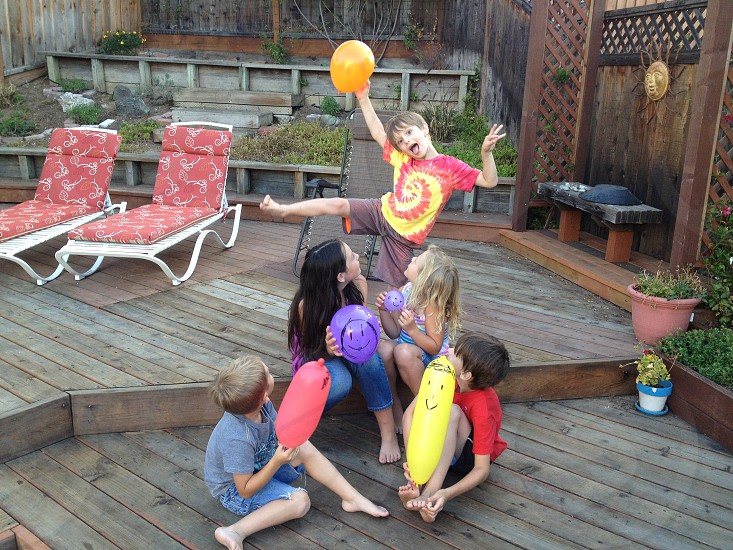 children playing with balloon photo