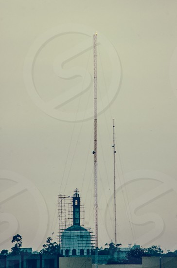 Lahore Urban Landscape 2016 telecommunication tower and mosque construction hazy evening photo