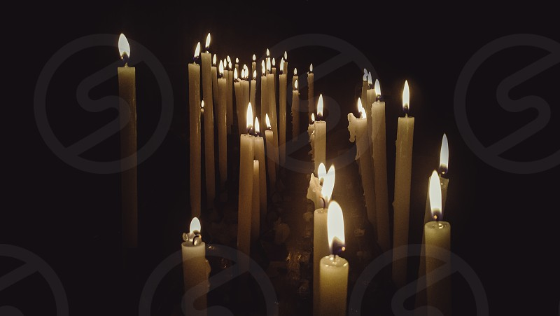 church candles lit with dramatic effect photo
