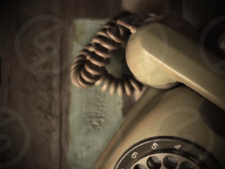 vintage telephone on wood desk in vintage color tone photo