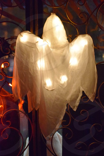 lighted ghost decorative hanging on wall photo