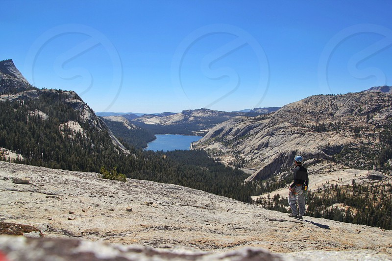 man in black long sleeved shirt standing on mountain slope photo