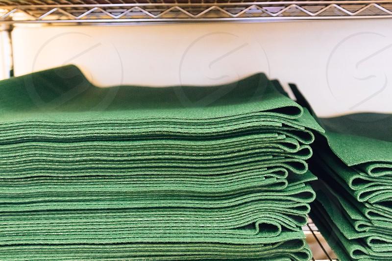 piled green paper mat photo