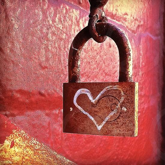 Painted heart on padlock photo