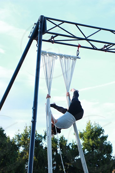 woman in black white striped tank top doing rope dancing photo