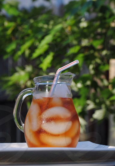 juice in clear glass pitcher photo