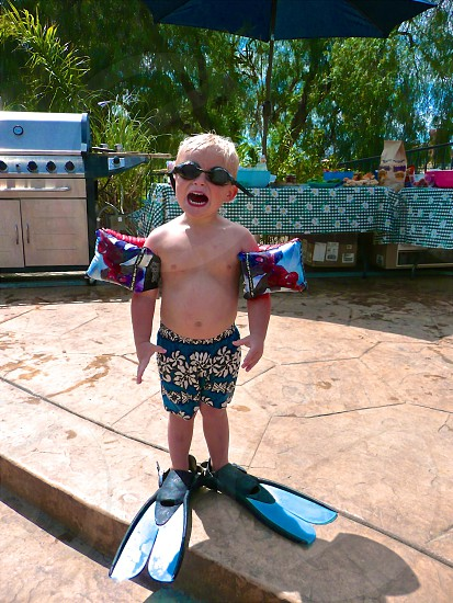 Boy floaters fins goggles pool Bbq party photo