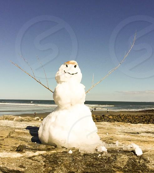 Beach snowman on the New England coast photo