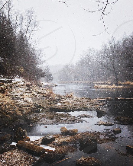 Snowing along river photo