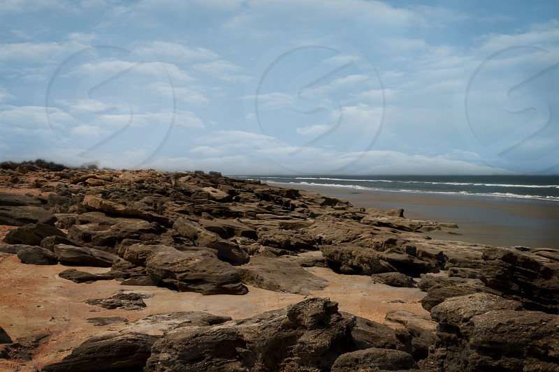 Large slabs of Coquina line the Beach at Palm Coast photo
