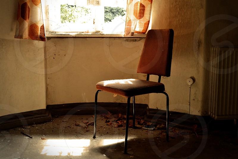 Orange chair abandoned TB clinic Sanatorium E photo