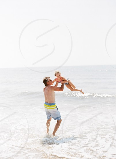 Grandfather granddaughter love family life Maryland beach ocean lifestyle fun morning.  photo