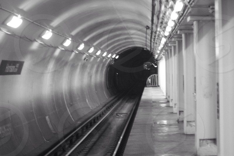 black and white underground train station photo
