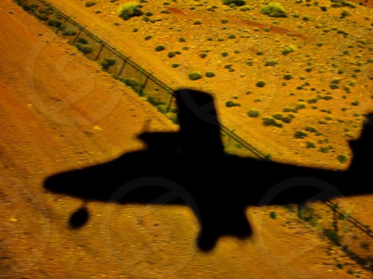 Small aircraft landing shadow photo