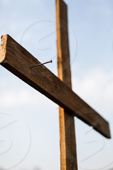 Nail in a wooden cross photo