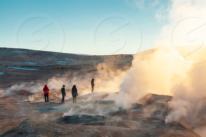 Sunrise between geysers in Bolivia photo