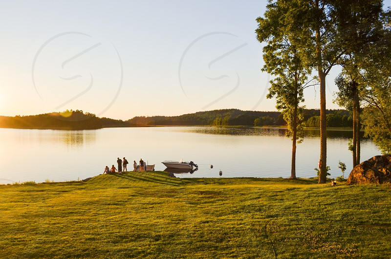 lake boat dock sunset friends nature photo