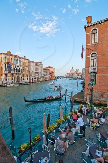 "Venice Italy grand canal view from the top of Accademia bridge with ""Madonna della Salute"" church on background photo"