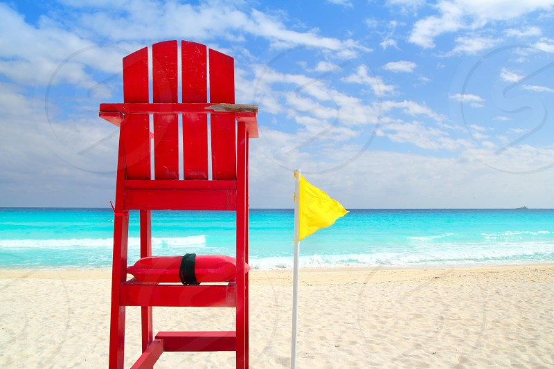 Baywatch red beach seat yellow wind flag in tropical caribbean sea photo