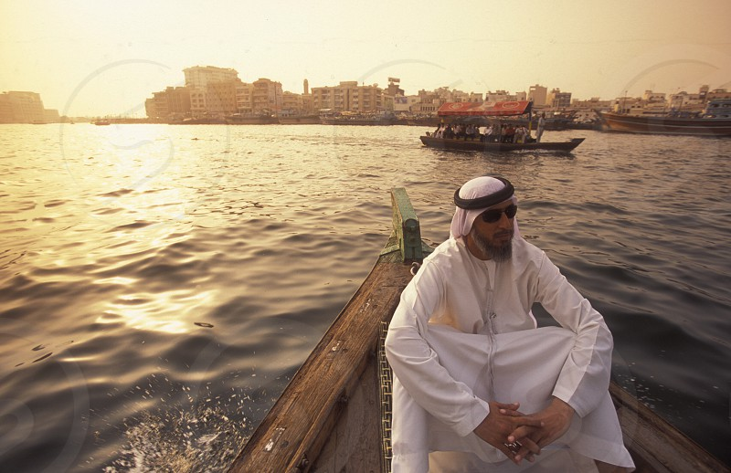 a city boat and ferry on the Dubai creek in the old town in the city of Dubai in the Arab Emirates in the Gulf of Arabia. photo