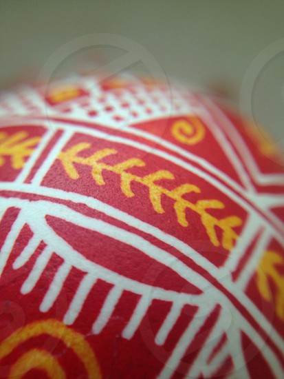 red white and yellow textile photo