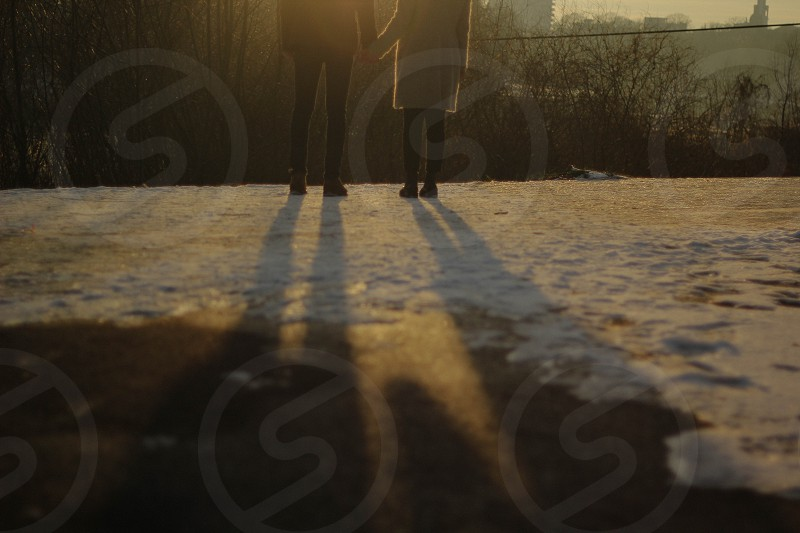 Couple in the winter sunset photo