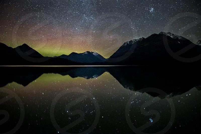 The Northern Lights dance above Alaska. Aurora Borealis.  photo