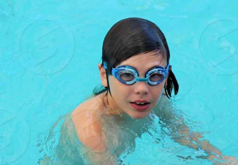 girl in goggles swimming photo