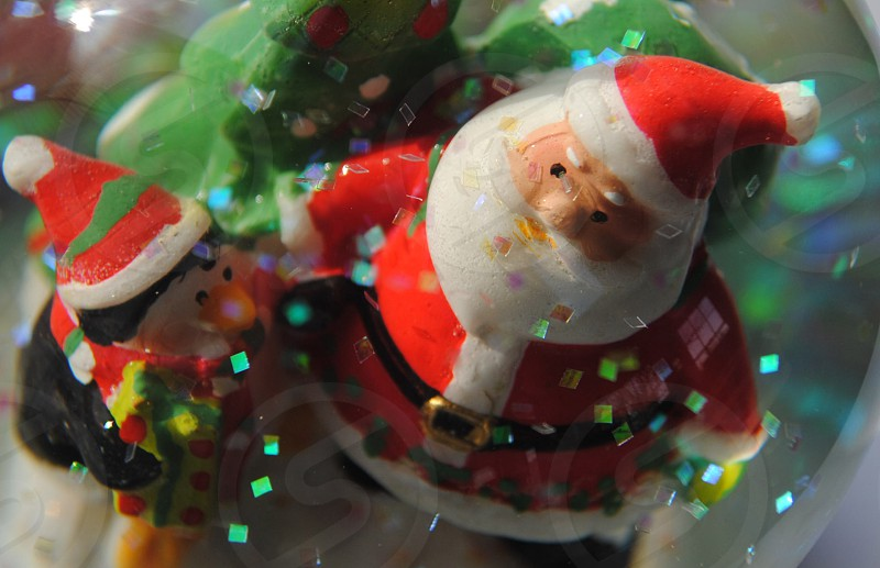 red santa claus figure with elf photo