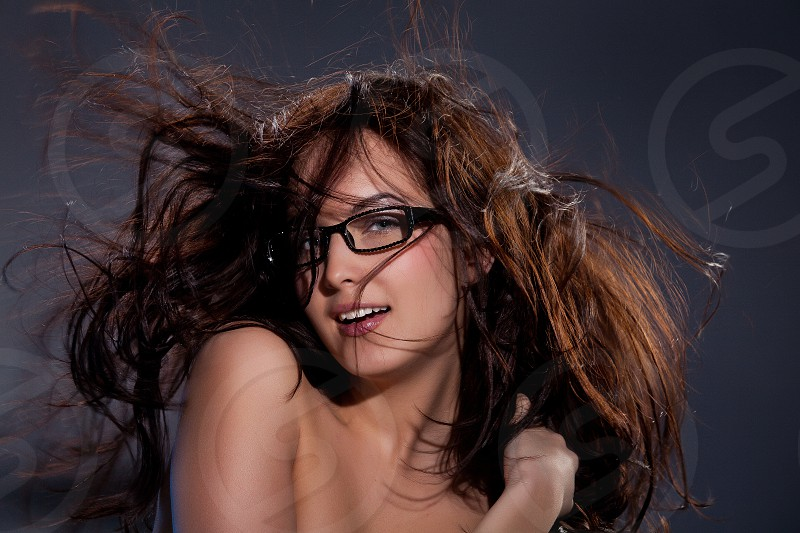 Young beautiful girl in glasses with waving hair photo