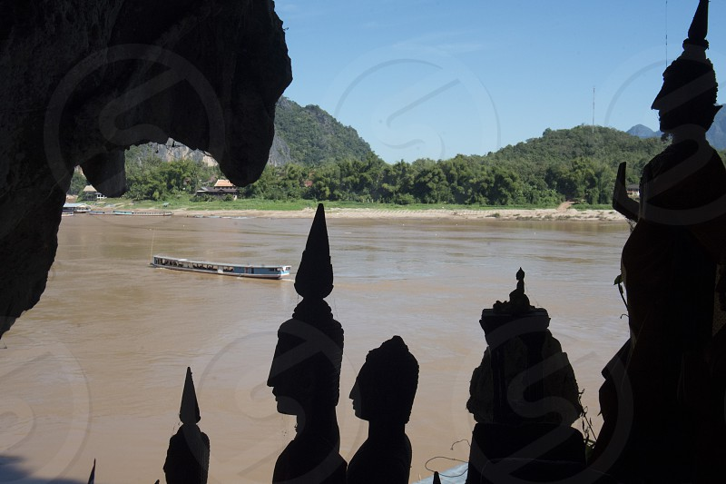 buddha figures at the Buddha Cave of Pak Ou Caves at the Mekong River in the town of Luang Prabang in the north of Laos in Southeastasia. photo