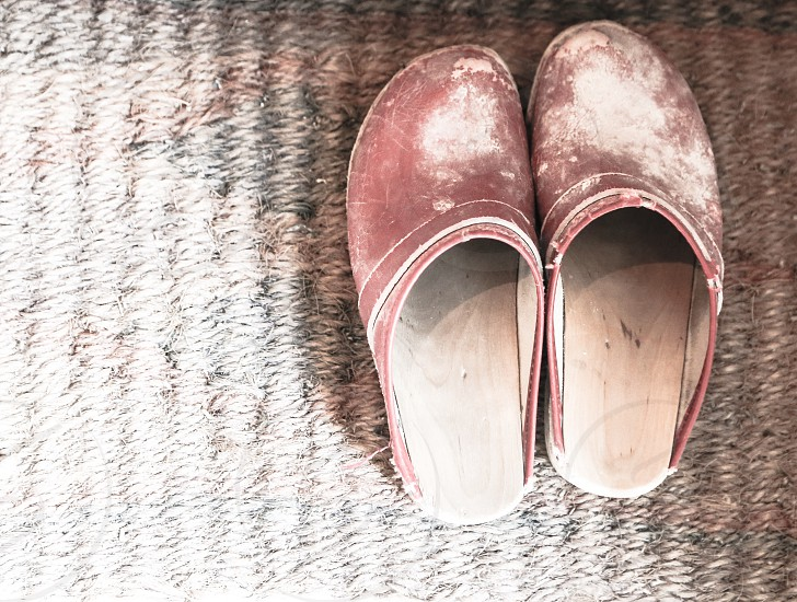 Background wooden wood wooden shoes leather material clay doormat dirt dirty tidy cleanup spacious shoes clogs fashion dressed left abandoned walk feet  footwear foot photo