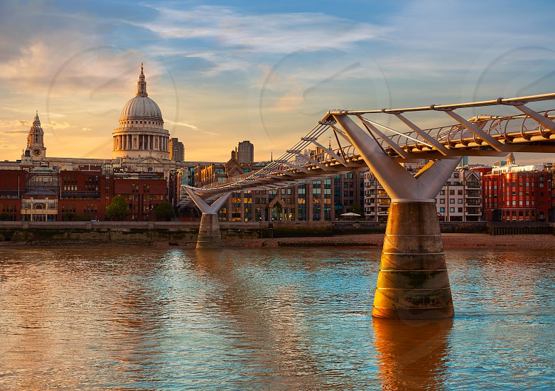London St Paul Pauls cathedral sunset from Millennium bridge on Thames UK photo