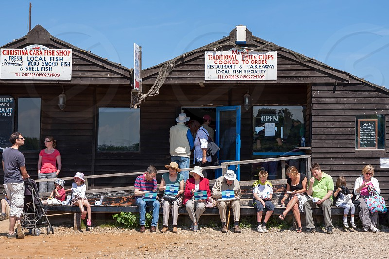 People Enjoying Fish and Chips in Southwold photo