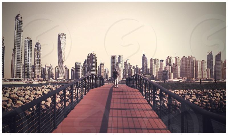 Dubai skyline from a bridge on Palm island. photo