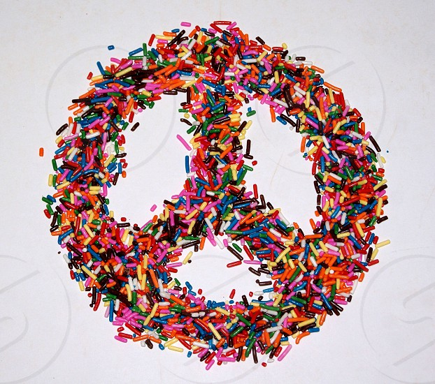Peace sign of bright candies photo