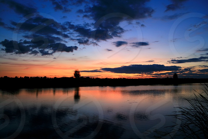 Sunset outdoor reflection landscape evening water river beautiful clouds sky shadows color summer photo