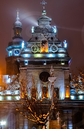 Old church central part Lviv city Ukraine building cathedral architecture europe monument exterior light night scene photo