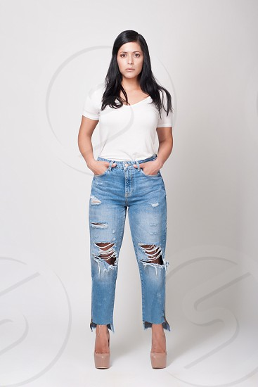 A young woman with jeans white shirt and high heels Beauty beautiful life lifestyle face makeup model Photoshoot NIKON model elegant elegance makeup style stylish shoes outfit Spanish Hispanic Latino girl woman female photography makeup modeling pose summer light enjoy living moda fashion apparel dress up  dressing up.  photo