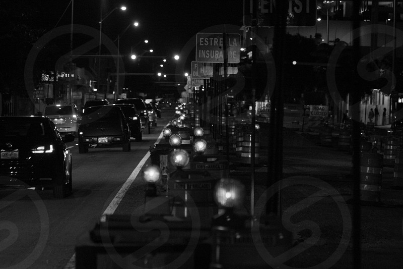 black and white image of street lamps at night photo