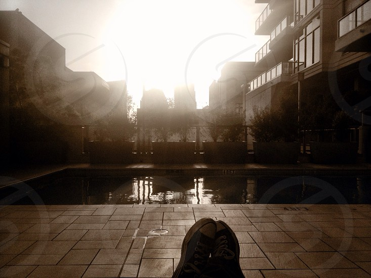 Wearing chucks by the pool on a sunny winter afternoon in downtown San Diego.  photo