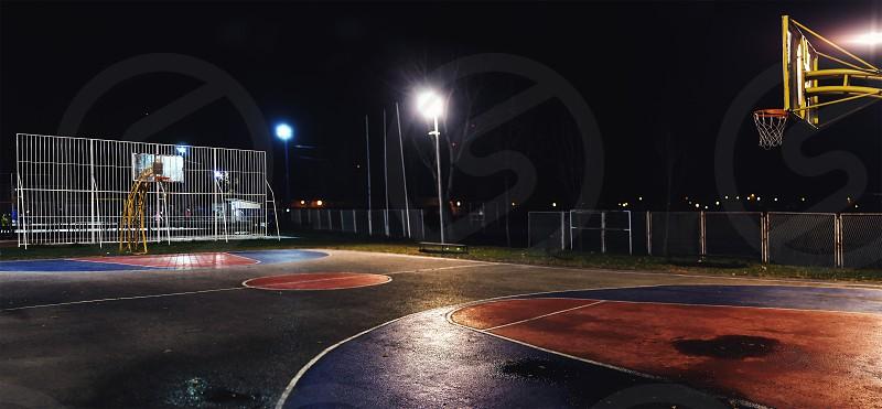 Street basketball yard by night outdoor scene. photo