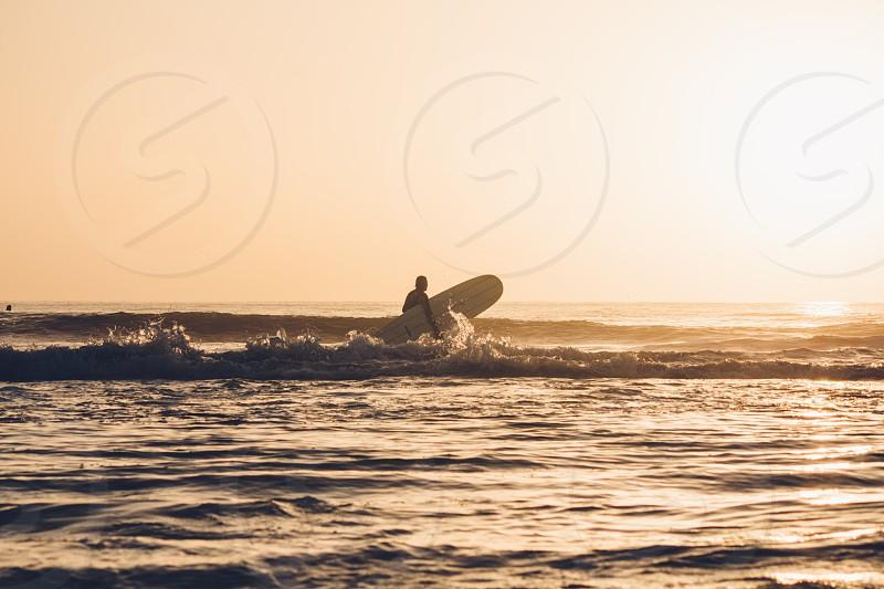 surfersunrisefloridalongboardsurfwavessun photo