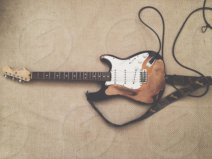 black and white brown electric guitar  photo
