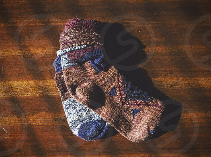 Rolled up pair of socks on wood background.  photo